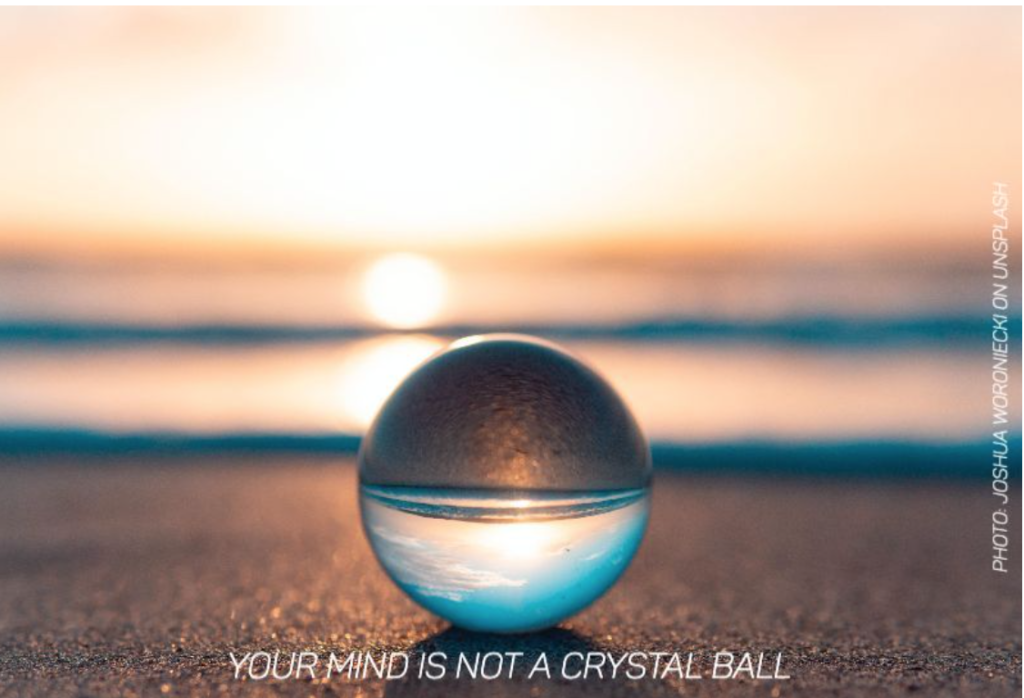 "Picture of a crystal ball on a beach reflecting an ocean with caption ""Your mind is not a crystal ball."""