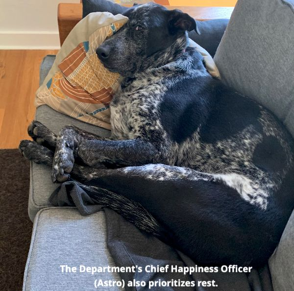 The Department's Chief Happiness Officer, Astro (our black and white dog), also prioritizes rest.
